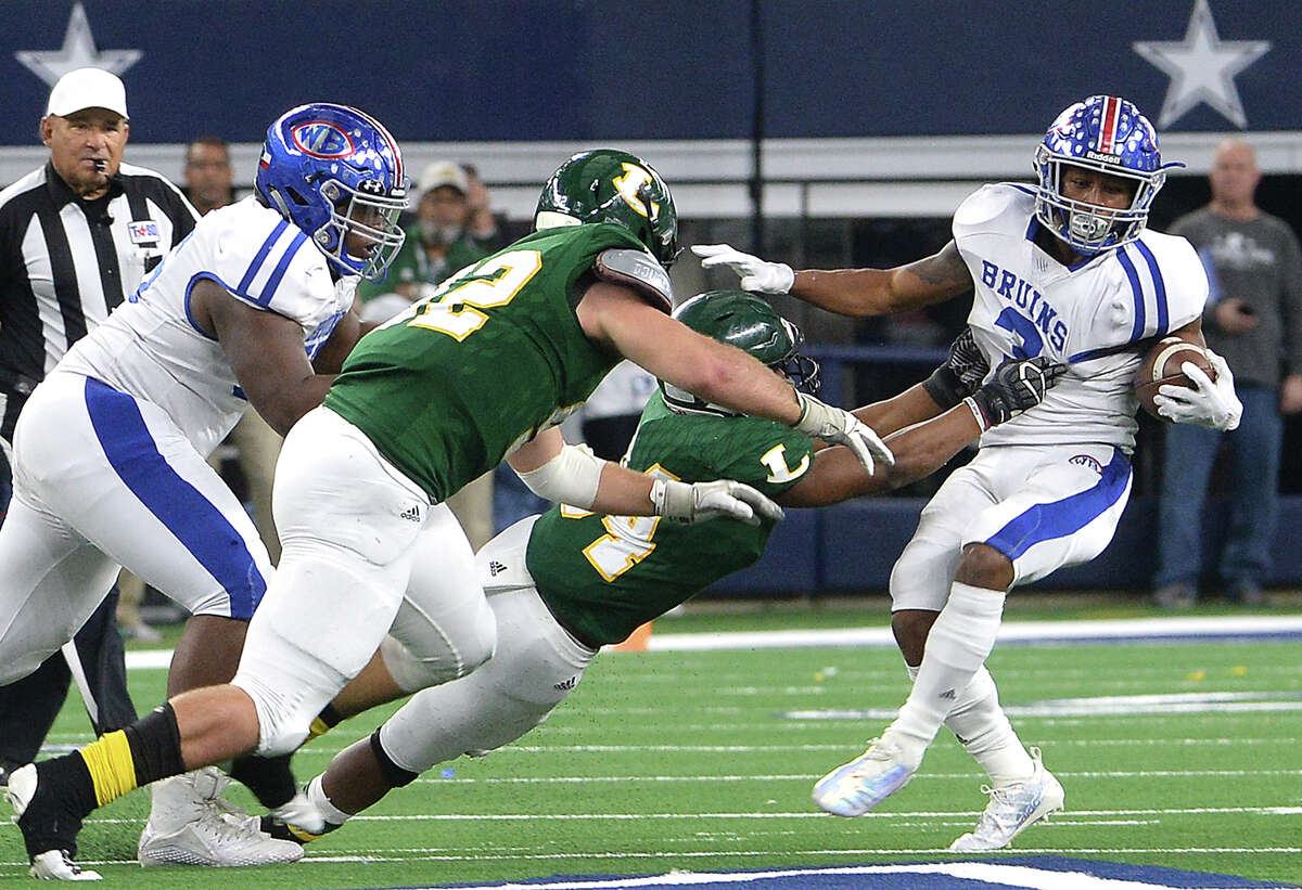 West Brook's Robert McGrue pulls away from Longview's defense during Saturday's state final Class 6A Div. II championship game at AT&T Stadium in Arlington. Photo taken Saturday, December 22, 2018 Kim Brent/The Enterprise