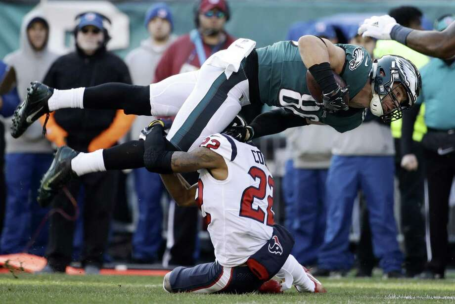 Philadelphia Eagles' Zach Ertz (86) is tackled by Houston Texans' Aaron Colvin (22) during the first half of an NFL football game, Sunday, Dec. 23, 2018, in Philadelphia. Photo: Matt Rourke, STF / Associated Press / Copyright 2018 The Associated Press. All rights reserved