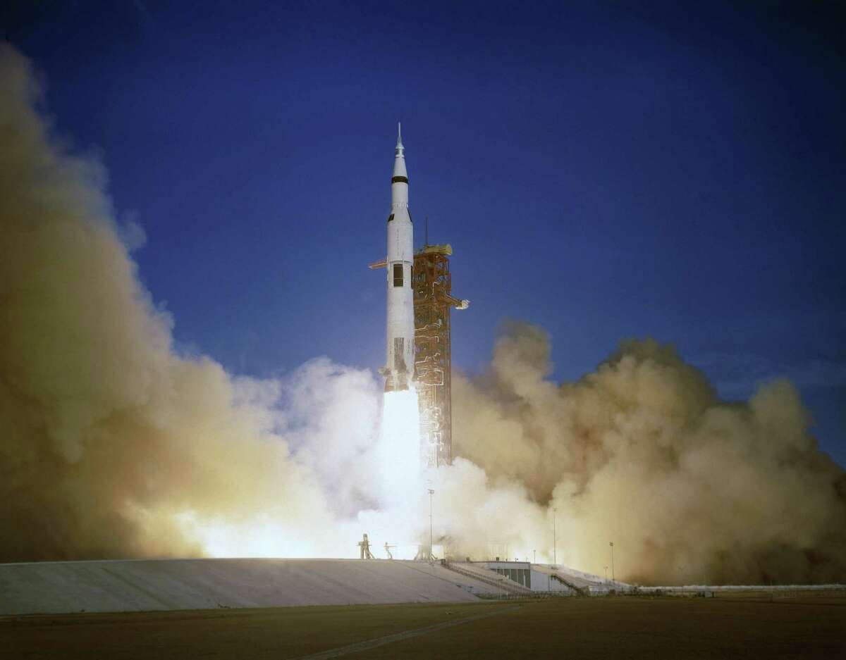 FILE - In this Dec. 21, 1968, file photo, the Apollo 8 crew lifts off from the Kennedy Space Center in Florida. Friday, Dec. 21, 2018 marks the 50th anniversary of the historic mission. (AP Photo/File)