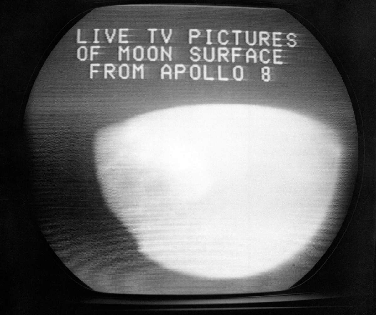 FILE - This Dec. 24, 1968, file photo shows a television screen with a view of the moon transmitted by the Apollo 8 astronauts as it orbited. The curves within the television image are caused by the edges of the spacecraft windows and the lunar horizon. (AP Photo/Anthony Camerano, File)