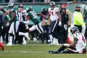 Houston Texans quarterback Deshaun Watson (4) sits on the field after giving up a fumlbe against the Philadelphia Eagles during the fourth quarter of an NFL football game at Lincoln Financial Field on Sunday, Dec. 23, 2018, in Philadelphia.