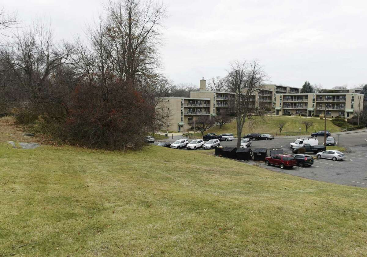 The hill in which a new apartment building will be constructed in the coming months at the Armstrong Court public housing complex in the Chickahominy section of Greenwich, Conn. Thursday, Dec. 20, 2018. The town is planning a project that will add a new building to the complex and renovate interiors and exteriors of the existing buildings.