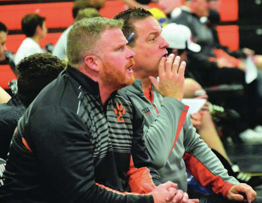 Edwardsville coach Jon Wagner (right) and assistant Doug Heinz watch the heavyweight match during a SWC dual with Alton during the 2017-18 regular season in Edwardsville. Photo: Matt Kamp/Intelligencer