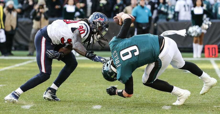 Houston Texans outside linebacker Jadeveon Clowney (90) sacks Philadelphia Eagles quarterback Nick Foles (9) to nullify a two-point conversion attempt during the first half of an NFL football game at Lincoln Financial Field on Sunday, Dec. 23, 2018, in Philadelphia. Photo: Brett Coomer/Staff Photographer