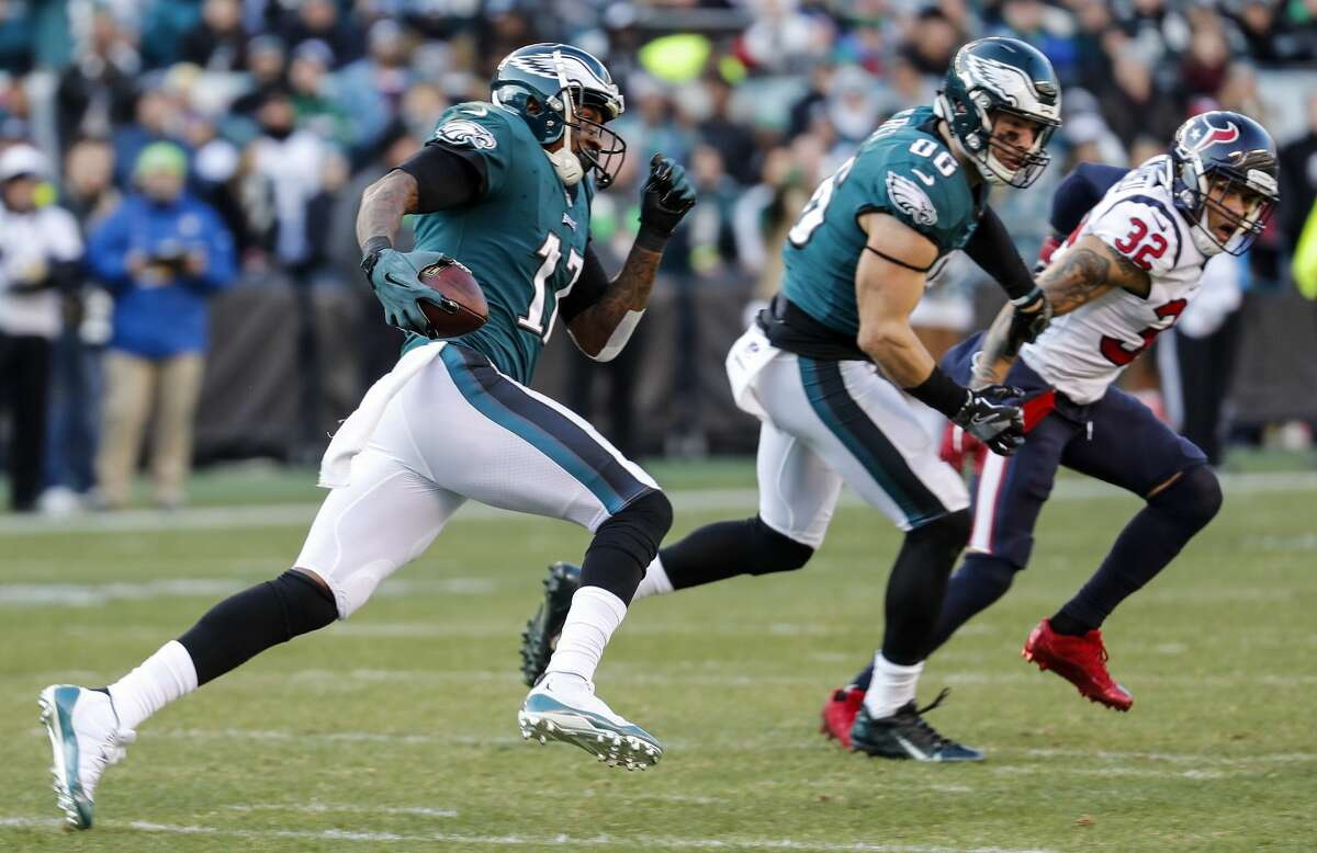 Philadelphia Eagles wide receiver Alshon Jeffery (17) runs upfield as he make a first down reception with Houston Texans free safety Tyrann Mathieu (32) giving chase during the third quarter of an NFL football game at Lincoln Financial Field on Sunday, Dec. 23, 2018, in Philadelphia.