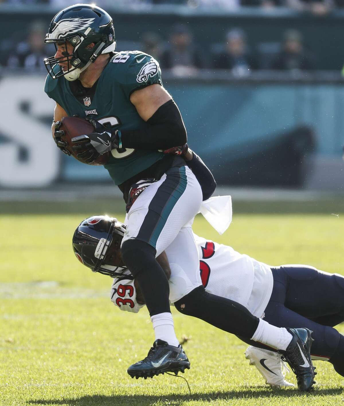 Philadelphia Eagles tight end Zach Ertz (86) makes a first down reception against Houston Texans defensive back Deante Burton (39) during the first half of an NFL football game at Lincoln Financial Field on Sunday, Dec. 23, 2018, in Philadelphia.