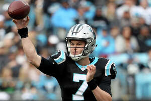 CHARLOTTE, NORTH CAROLINA - DECEMBER 23: Kyle Allen #7 of the Carolina Panthers drops back to pass against the Atlanta Falcons in the second quarter during their game at Bank of America Stadium on December 23, 2018 in Charlotte, North Carolina. (Photo by Streeter Lecka/Getty Images)
