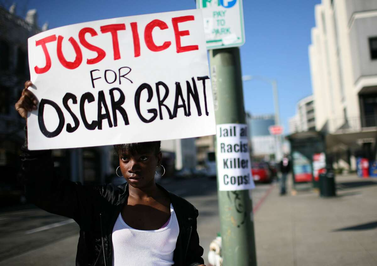 Javone Sloan protests Oscar Grant's killing in Oakland in January 2009.
