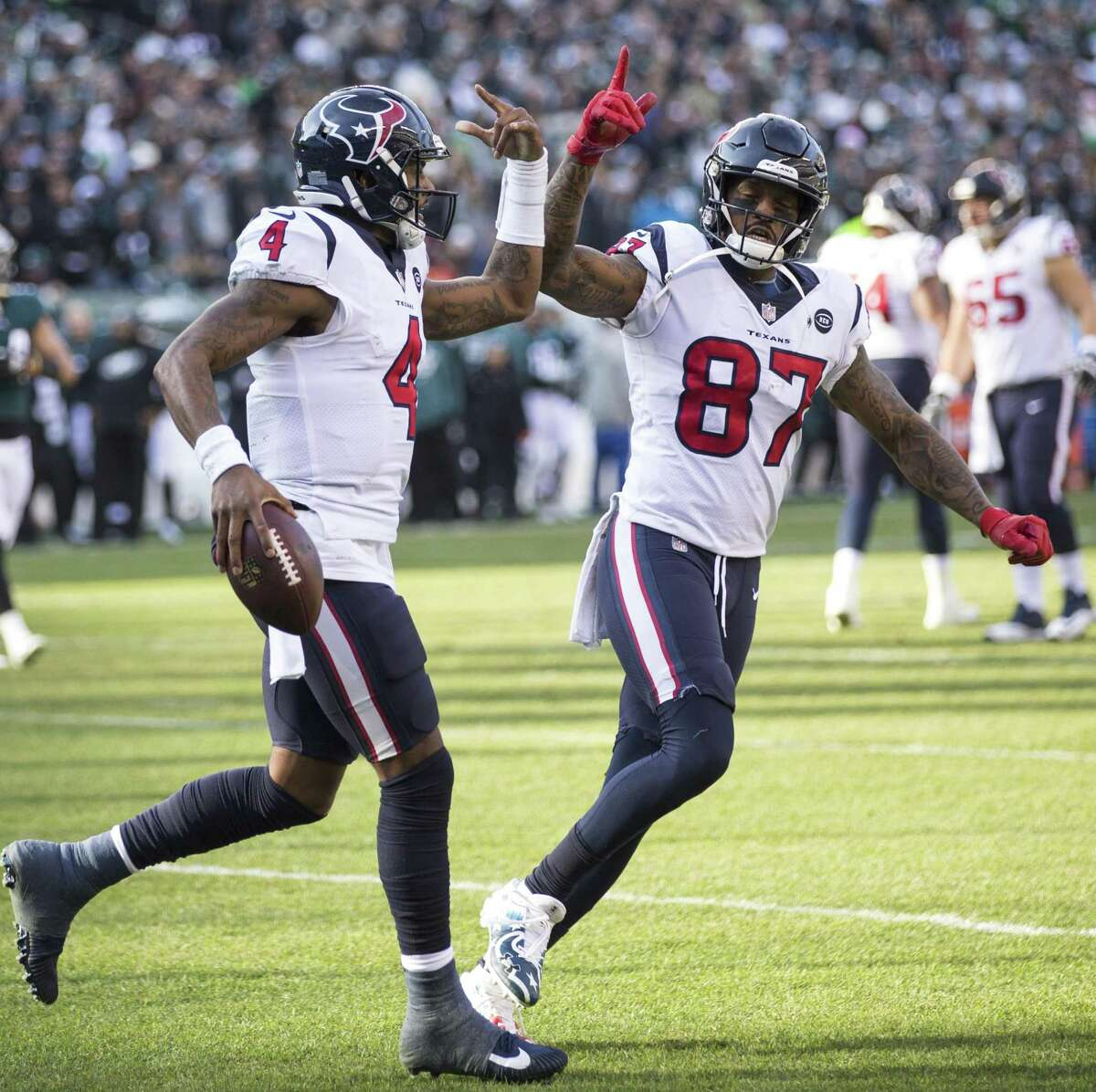 Houston Texans quarterback Deshaun Watson (4) and Houston Texans wide receiver Demaryius Thomas (87) celebrate Watson's 6-yard touchdown run against the Philadelphia Eagles during the first half of an NFL football game at Lincoln Financial Field on Sunday, Dec. 23, 2018, in Philadelphia.