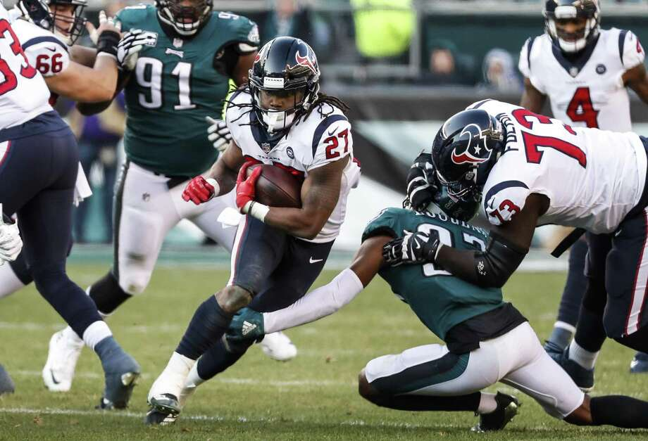 Houston Texans running back D'Onta Foreman (27) is tripped up by Philadelphia Eagles defensive back Tre Sullivan (37) as he runs up the middle during the third quarter of an NFL football game at Lincoln Financial Field on Sunday, Dec. 23, 2018, in Philadelphia. Photo: Brett Coomer, Houston Chronicle / Staff Photographer / © 2018 Houston Chronicle