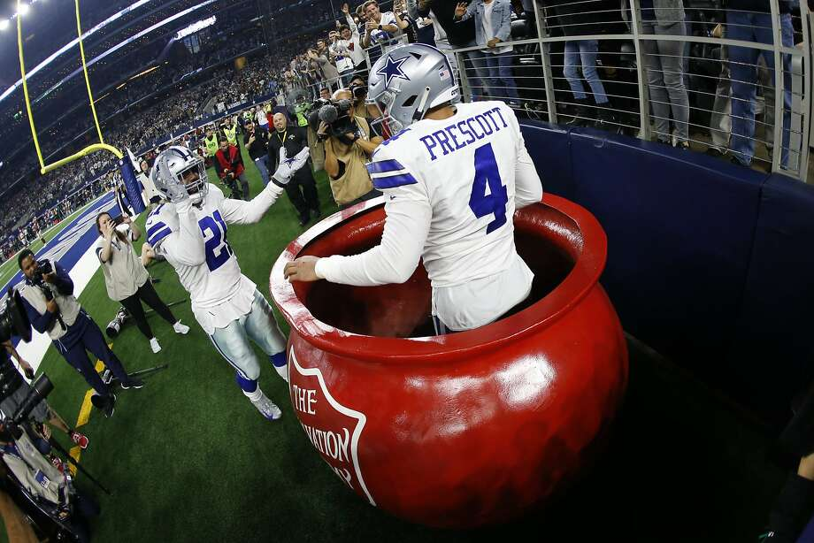 cc2ae873f Cowboys quarterback Dak Prescott (4) celebrates his touchdown after being  lifted into a Salvation