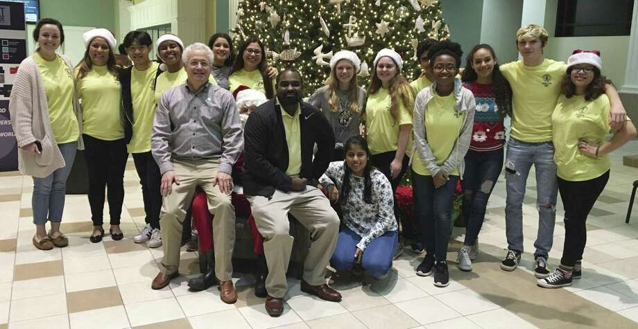 Members of Conroe High School Interact Club gather to host their annual dinner for moms and kids staying at The Montgomery Women's Shelter during this holiday season.
