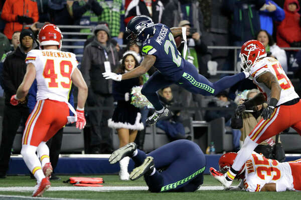 Seattle Seahawks running back J.D. McKissic center, leaps above Kansas City Chiefs cornerback Charvarius Ward (35) during the first half of an NFL football game, Sunday, Dec. 23, 2018, in Seattle. (AP Photo/Elaine Thompson)