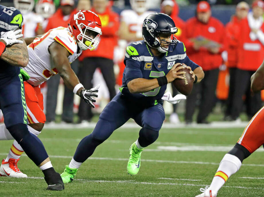 RUSSELL WILSON (SEATTLE SEAHAWKS) Grade: 87.2 Photo: Elaine Thompson/AP / Copyright 2018 The Associated Press. All rights reserved.