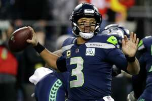 Seattle Seahawks quarterback Russell Wilson passes against the Kansas City Chiefs during the first half of an NFL football game, Sunday, Dec. 23, 2018, in Seattle. (AP Photo/Elaine Thompson)