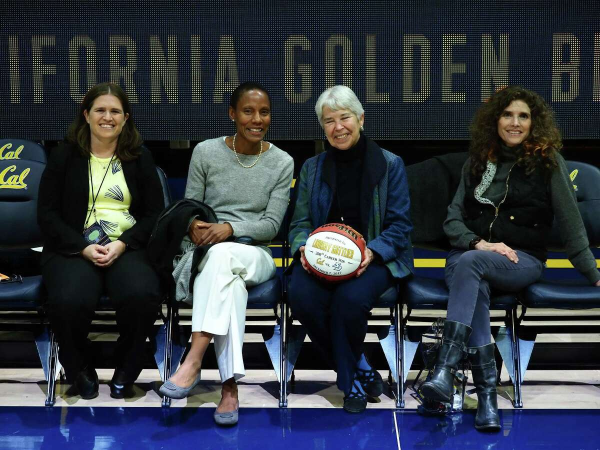 (From left) Jenny Simon-O'Neill, Vice Chancellor Khira Griscavage, and Chancellor Carol Christ at a January women's basketball game at Haas Pavilion.