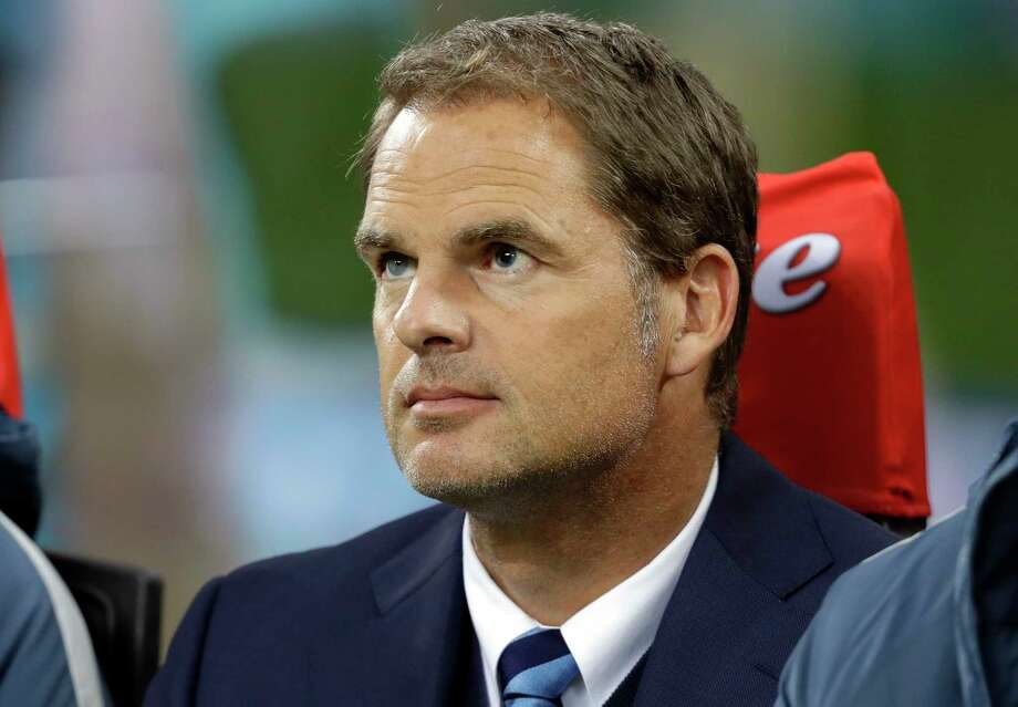 FILE - In this Oct. 26, 2016, file photo, Inter Milan coach Frank De Boer waits for the start of the Serie A soccer match between Inter Milan and Torino at the Milan San Siro stadium. Frank de Boer, who appeared in two World Cups during an illustrious playing career and went on to capture four straight league titles as a coach at Ajax, is taking over at Atlanta United. The Major League Soccer champions announced the move Sunday, Dec. 23, 2018. (AP Photo/Luca Bruno, File) Photo: Luca Bruno / Copyright 2016 The Associated Press. All rights reserved.
