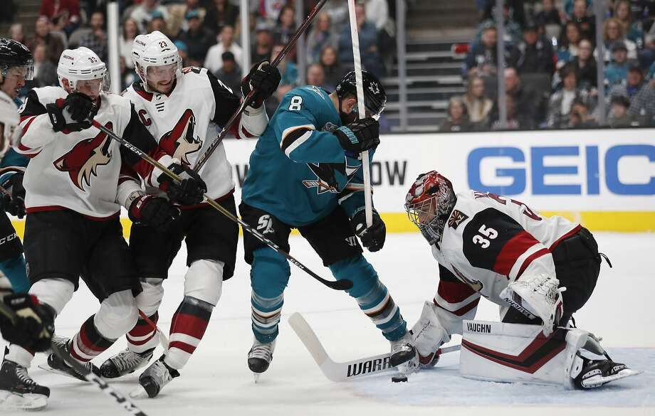 Sharks' Joe Pavelski (8) battles for the puck against Coyotes goalie Darcy Kuemper on Sunday in San Jose. Photo: Josie Lepe / Associated Press