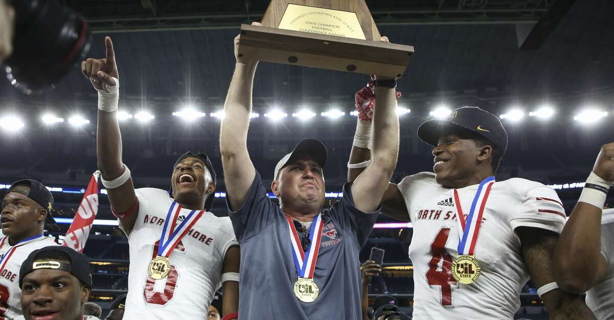 Galena Park North Shore head coach Jon Kay hoists the 6A Division 1 State Championship title toward the fans after defeating Duncanville 41-36 at AT&T Stadium Saturday, Dec. 22, 2018, in Arlington, Texas.
