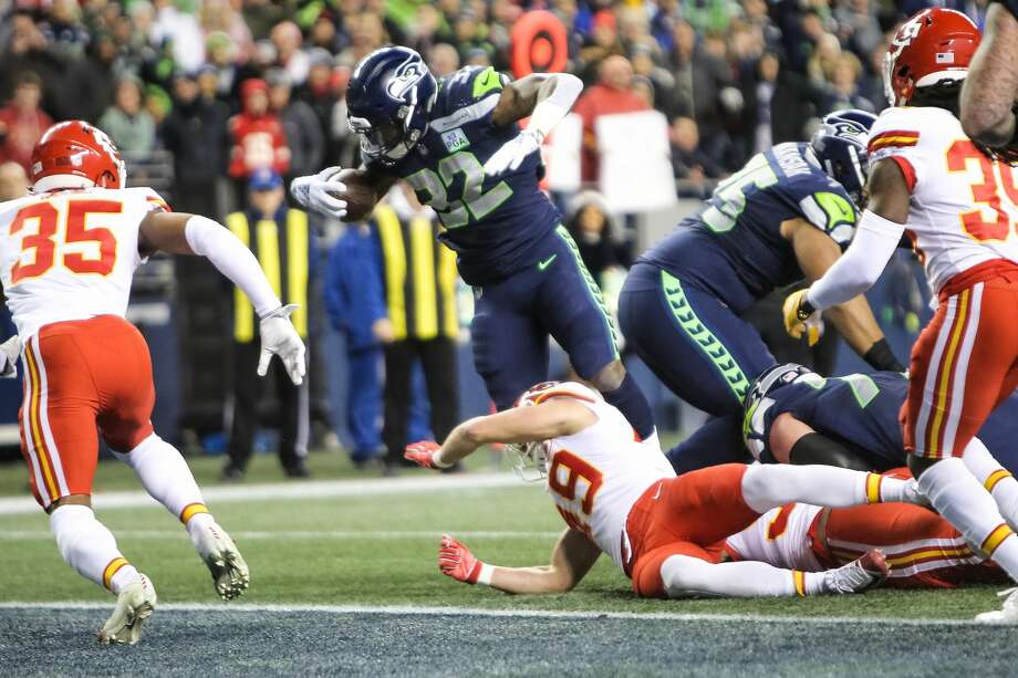 """You spent a first-round pick on Rashaad Penny last year, but you got a lot more out of second-year pro Chris Carson, who was a seventh-round pick. What do you hope to get from both moving forward?  Carroll: """"1-2 punch. I don't know who's 1 or who's 2, it doesn't matter to me. I thought both guys did really good this year. Chris had a fantastic season. It's the first time Chris has really had an opportunity to play a whole season all the way through, and show what he's all about. It was exhilarating to watch him have that opportunity and to see him play. His style was great. Love the way he played.  """"Rashaad did a really good job. He got banged up a little bit and it kind of slowed his start, but once he got going, he showed the explosiveness and the speed and the dynamics. Those two guys, they're good football players and we love what they bring. They're not the same. Their running style is much different, but there's plenty of room for both of those guys. Excited for both of them."""" Photo: GENNA MARTIN / SEATTLEPI"""
