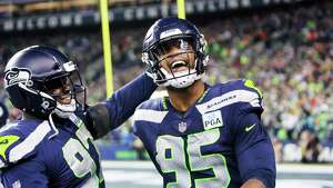 Seahawks defensive lineman Poona Ford and defensive lineman Dion Jordan celebrate after Jordan forced a Chief's fumble which was recovered by defensive lineman Jarran Reed in the second quarter of  Seattle's game against Kansas City, Sunday, Dec. 23, 2018.