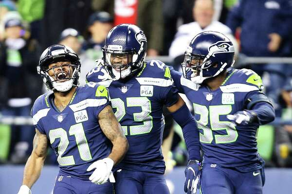 Seahawks running back J.D. McKissic, corner back Neiko Thorpe, and safety Maurice Alexander celebrate a special teams play in the third quarter of Seattle's game against Kansas City, Sunday, Dec. 23, 2018.
