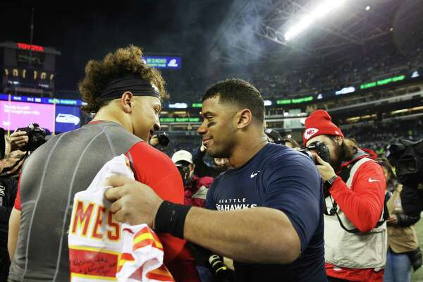 Quarterbacks Russell Wilson and Patrick Mahomes greet each other after Seattle's game against Kansas City, Sunday, Dec. 23, 2018.
