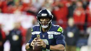 Seahawks quarterback Russell Wilson looks to throw in the second quarter of  Seattle's game against Kansas City, Sunday, Dec. 23, 2018.