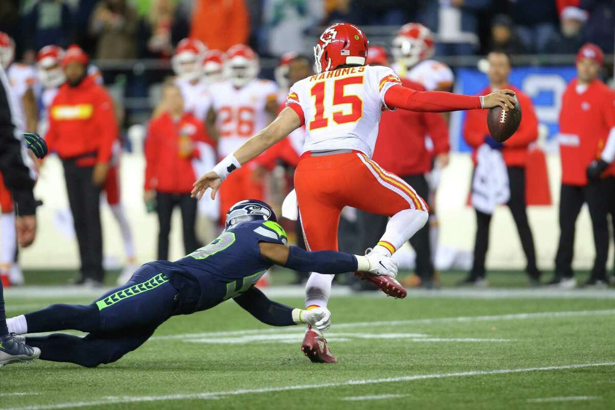 Seahawks defensive lineman Jacob Martin grabs a hold of Chief's quarterback Patrick Mahomes in the third quarter of Seattle's game against Kansas City, Sunday, Dec. 23, 2018.