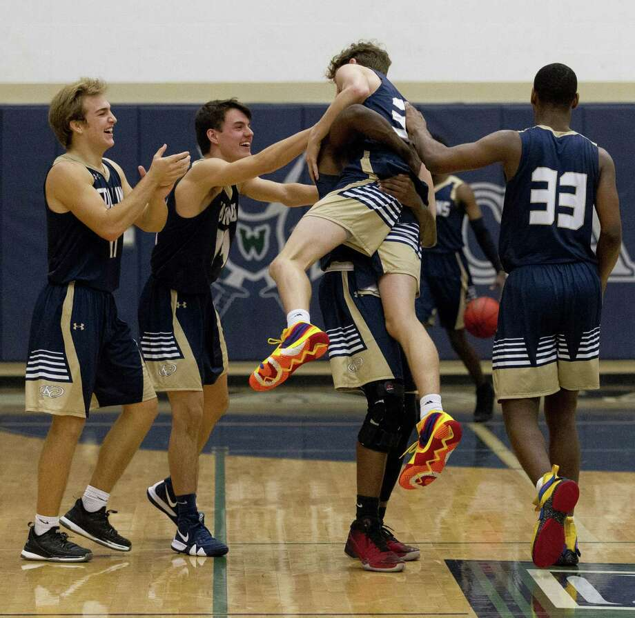 Klein Collins guard Trey South (32) is lifted up into the air by forward Marcus Hill (33) after the team's 74-64 win over College Park during a District 15-6A high school basketball game at College Park High School, Saturday, Dec. 8, 2018, in The Woodlands. Photo: Jason Fochtman, Houston Chronicle / Staff Photographer / © 2018 Houston Chronicle