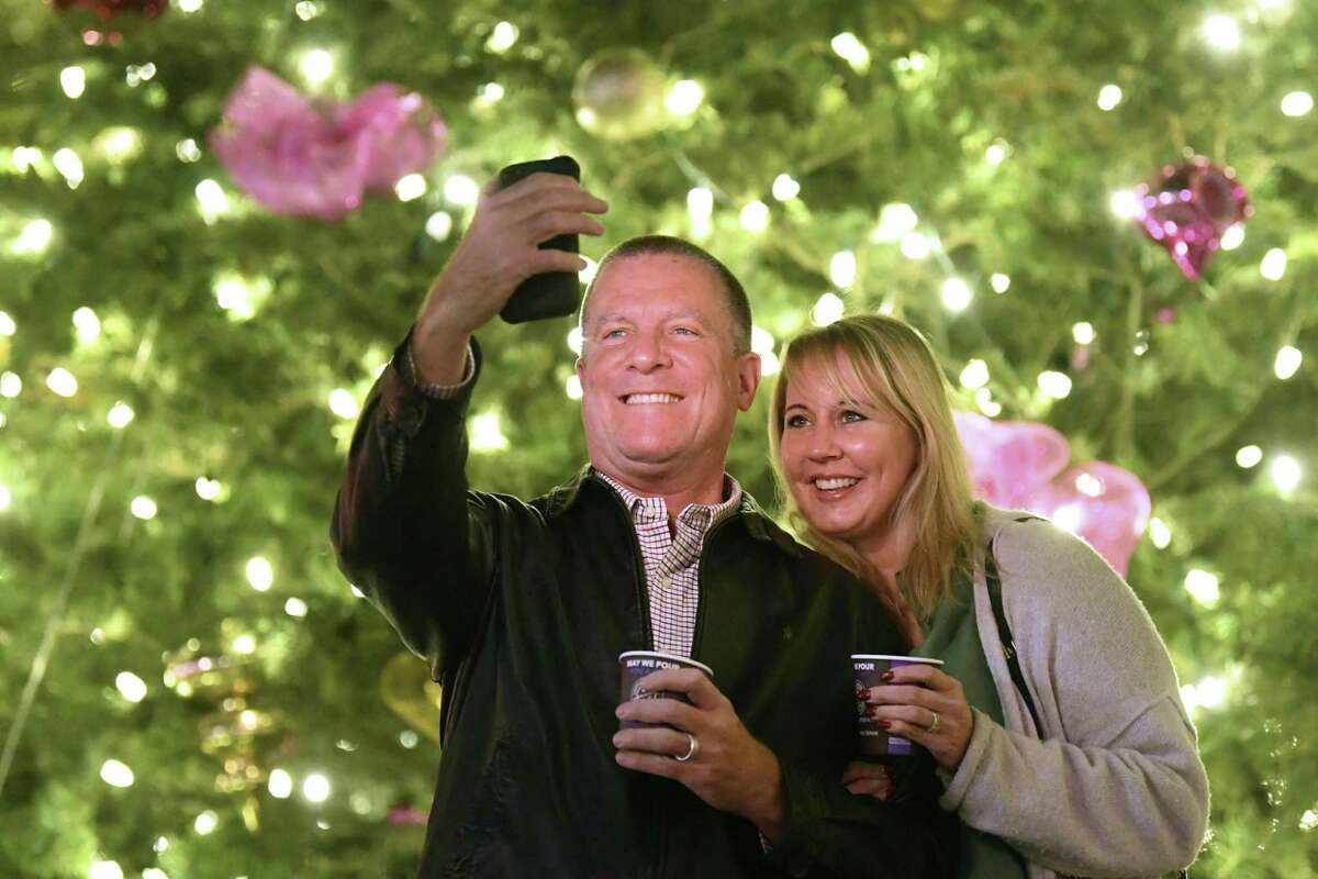 Scott and Michele Bailey visit the Christmas tree in Alamo Plaza. The city's official tree is in Travis Park, however.