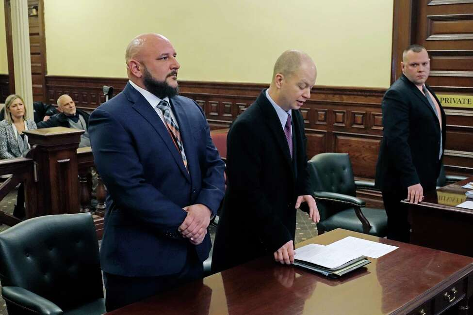 Troy Police Officer, Dominick Comitale, left, and his attorney, Bill Roberts, right, appear for Comitale's arraignment at the Rensselaer County Courthouse on Monday, Dec. 24, 2018, in Troy, N.Y. (Paul Buckowski/Times Union)