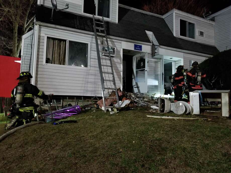 """Twenty-four residents were displaced in a six-unit complex on Bells Place in Danbury on Sunday, Dec. 23, 2018. """"Residents were evaluated by EMS and fortunately no one was injured. First arriving companies were able to quickly knock down the fire and salvage most of the Christmas gifts before they were damaged,"""" Danbury fire officials said in a release. Photo: Submitted Photo / Danbury Fire Department"""