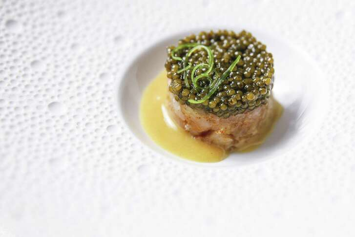 Hamachi crudo with osetra caviar, saffron cured yellowtail and blood orange buerre blanc at Tony's.