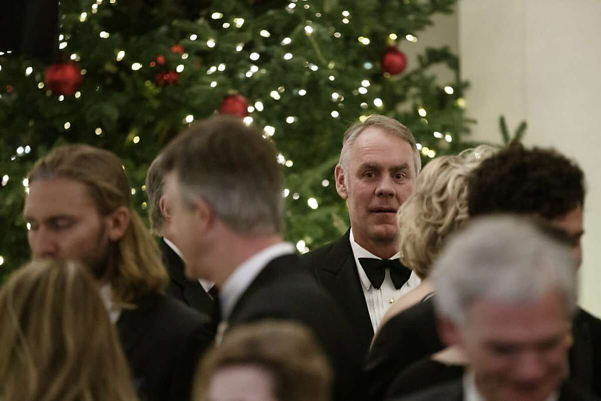 Secretary of the Interior Ryan Zinke attends the Congressional Ball in the Grand Foyer of the White House in Washington, Saturday, Dec. 15, 2018. (AP Photo/Carolyn Kaster)