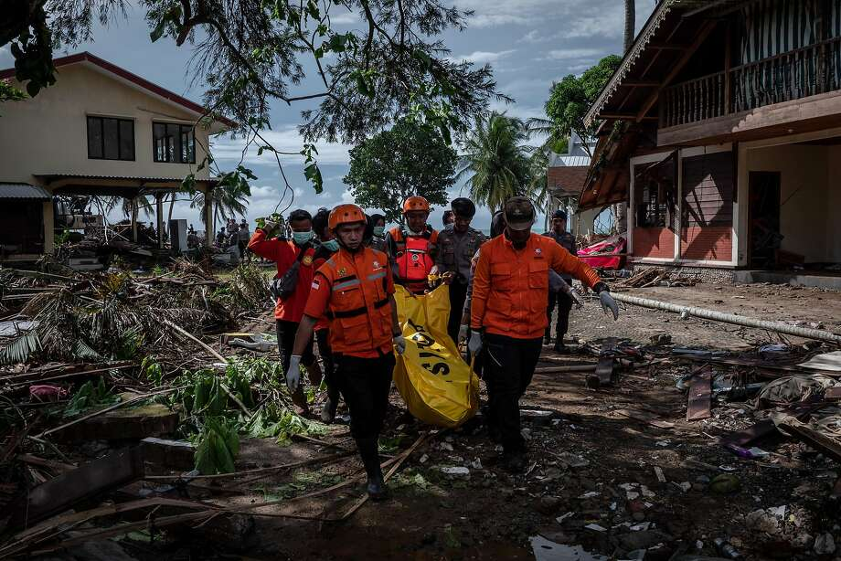 Emergency workers recover the body of a tsunami victim during a search of a hotel in Carita Beach. The tsunami followed an eruption and apparent landslide on Anak Krakatau, a volcanic island. Photo: Ulet Ifansasti / Getty Images