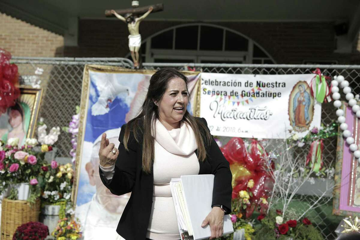 Mary Carmen Gallegos, who traveled twice to Rome in an effort to reopen the church, updates St. Stephen loyalists about their appeal to reopen the church.