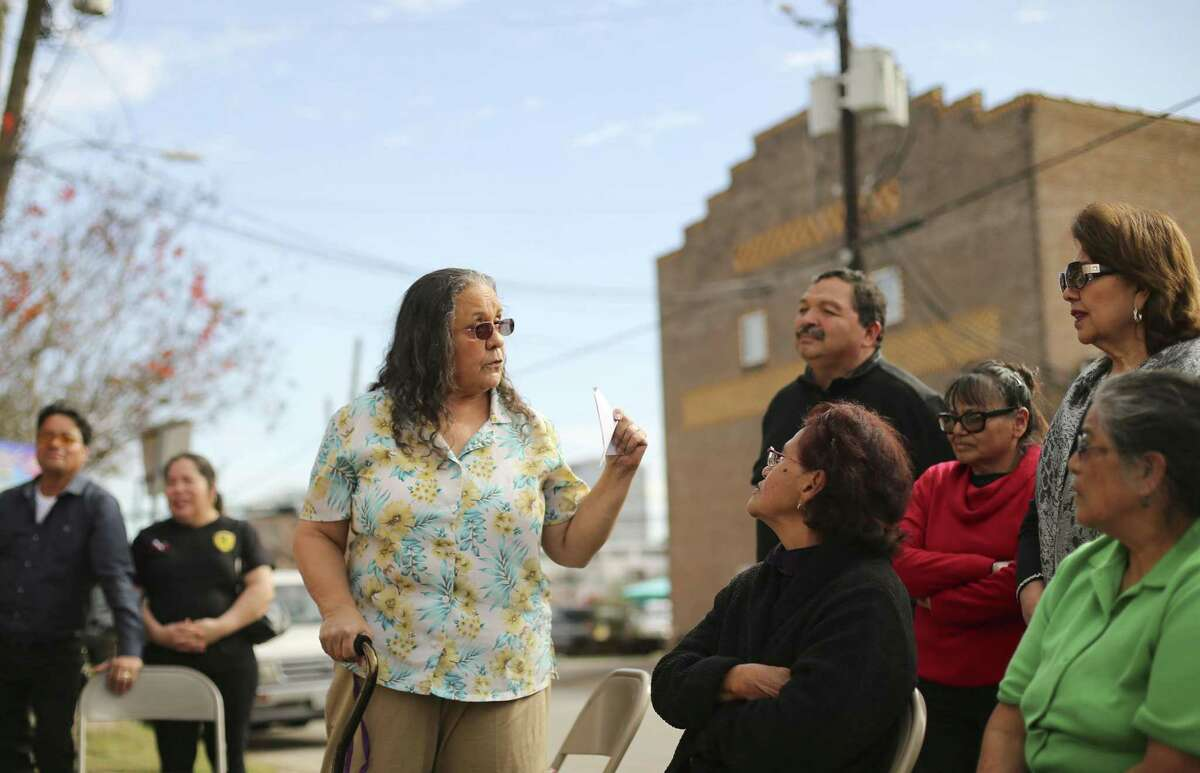 """Esperanza Fitch, one of """"los tres tigres,"""" talks with other St. Stephen supporters."""