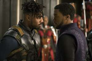 "This image released by Disney shows Michael B. Jordan, left, and Chadwick Boseman in a scene from Marvel Studios' ""Black Panther."" (Matt Kennedy/Marvel Studios-Disney via AP)"
