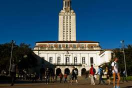 University of Texas students and faculty make thier way through campus via the UT Tower on Tues., Nov. 19, 2013 in Austin. The UT Chapter of the Young Conservatives of Texas planned to host a ìCatch an Illegal Immigrant Gameî on campus later this week. The game, which involved rewarding students with $25 gift cards if they ìcatchî volunteers posing on campus as an undocumented immigrants, was cancelled due to fear of retaliation from university officials. Contributed by Ashley Landis