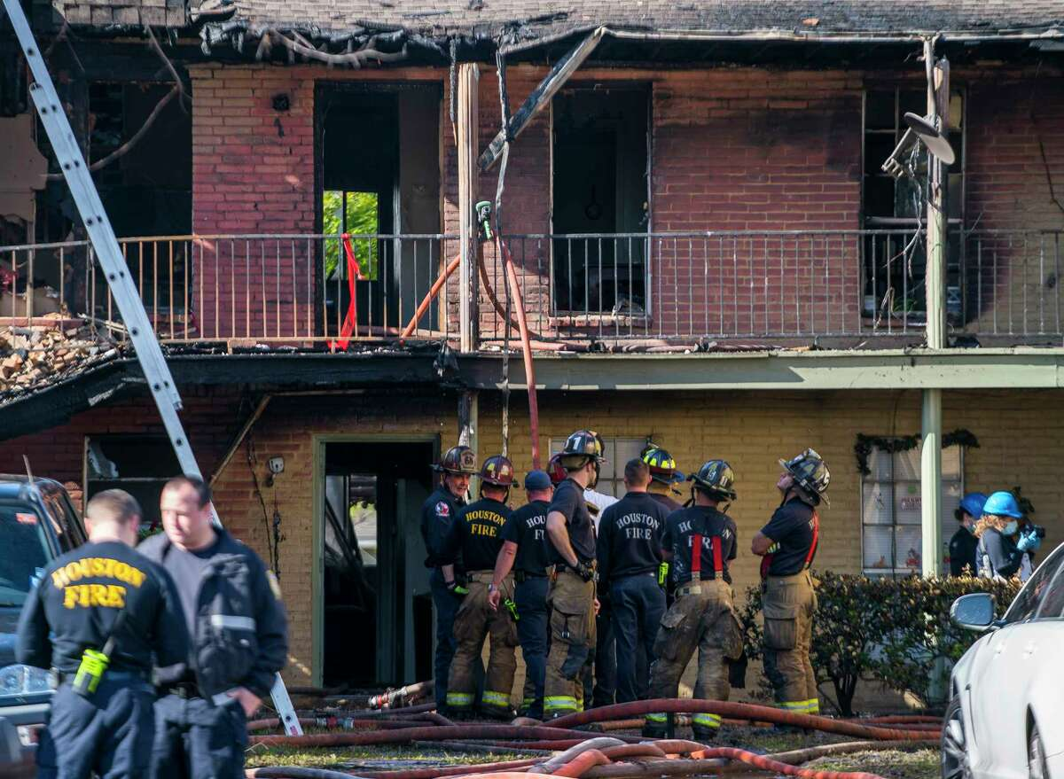 Fire fighters continue to clean up after fighting a fire at an apartment complex on S. Gessner Road near Bellaire Blvd., Monday, Dec. 24, 2018 in Houston.