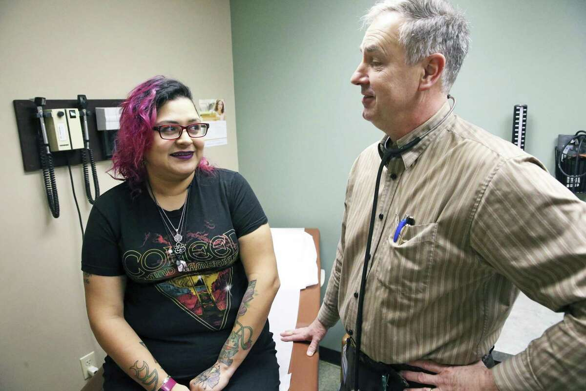 Sarah Lum talks to Dr. Douglas Denham during a recent examination. Lum is participating in a clinical trial in San Antonio for a form of oral insulin that Dr. Denham is conducting.