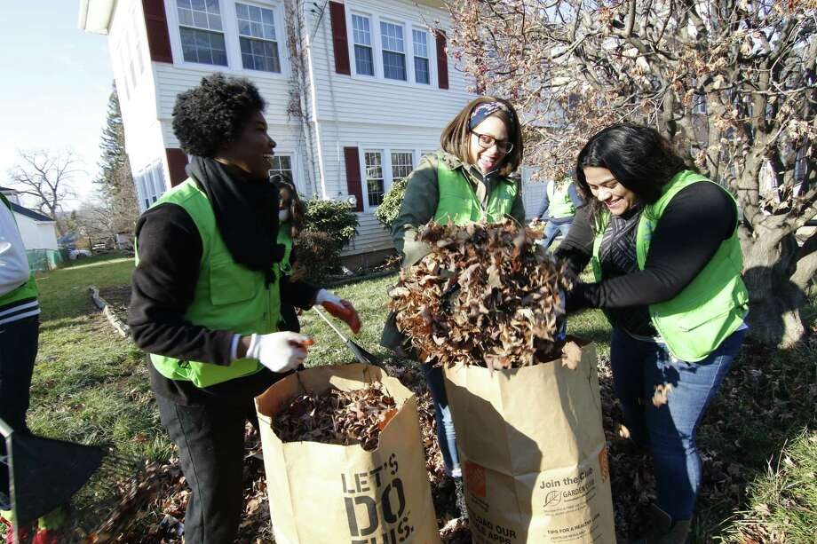 On Dec. 23, dozens of volunteers from the World Mission Society Church of God, including those from Middletown, braced for the cold, 34-degree weather and headed to Upper Albany Avenue in Hartford to provide leaf and yard cleaning service to senior citizens. Photo: Contributed Photo