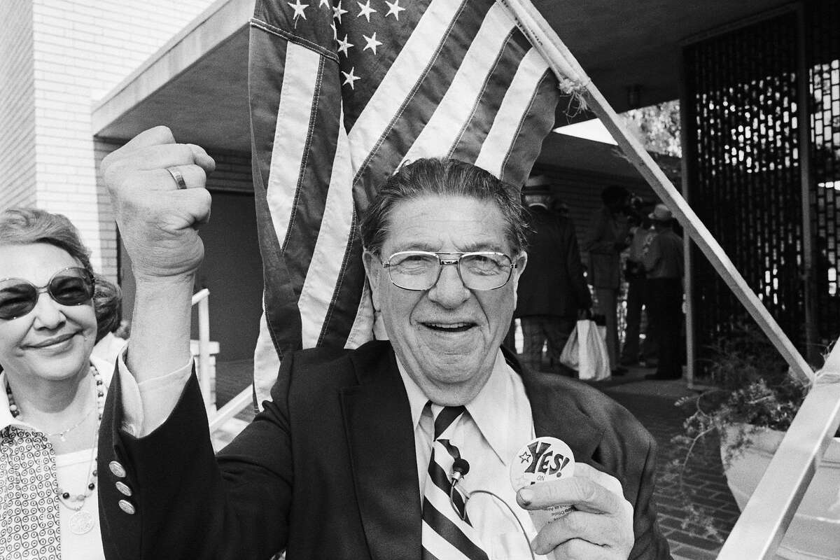 """Howard Jarvis, co-sponsor of Proposition 13, the property tax limitation initiative, holds a """"Yes on 13"""" message pin as he leaves a polling station after voting in the California primary. Voters approved the proposition, which calls for slashing of property taxes by about 57%."""