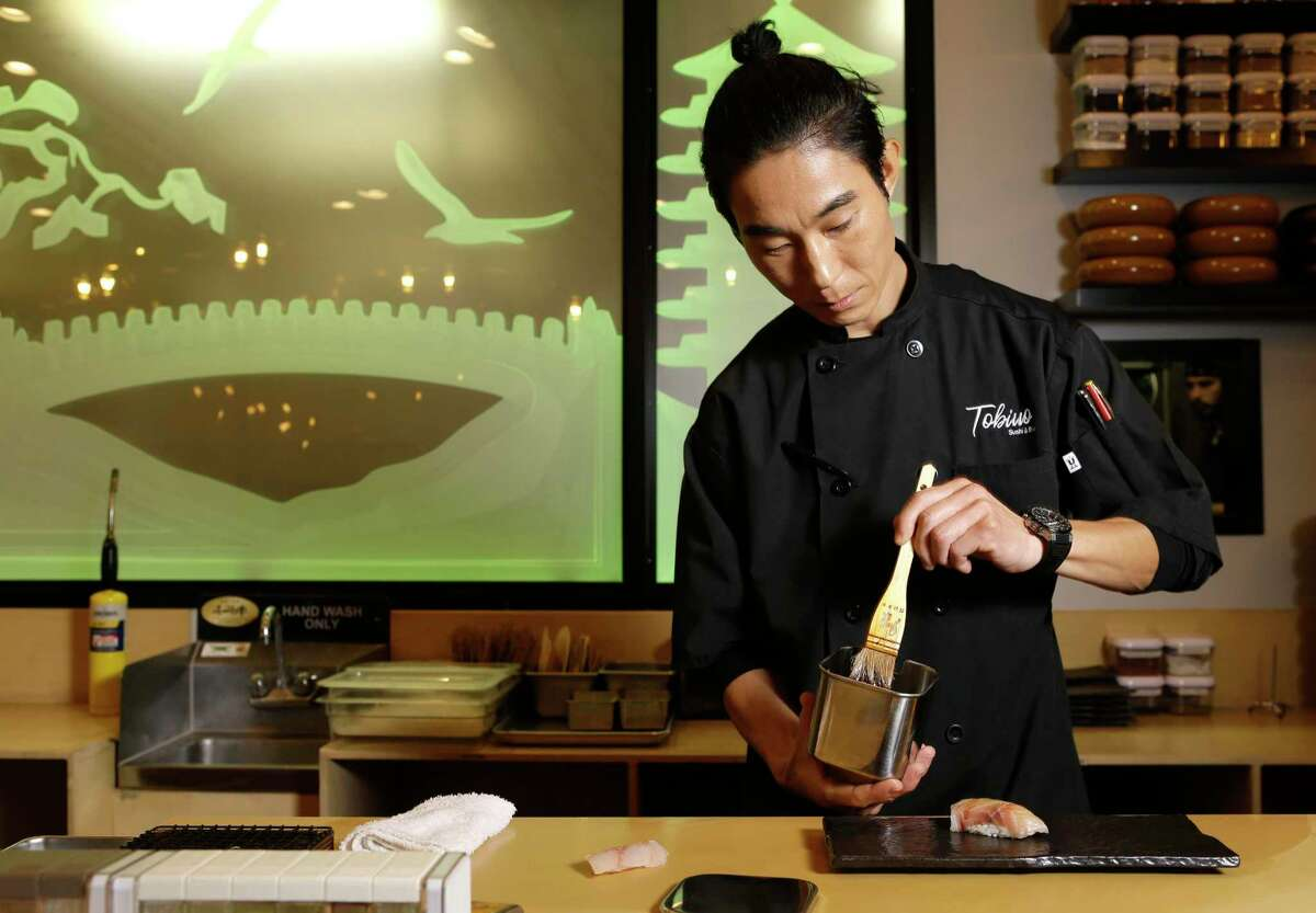 Sushi chef Mike Lim at work at Tobiuo Sushi & Bar in Katy. Lim has left Tobiuo to open his own restaurant, Kanau Sushi in Midtown, opening early 2020.