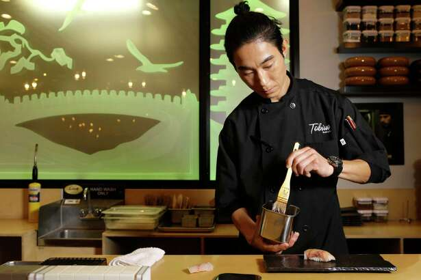 Sushi chef Mike Lim at work at Tobiuo Sushi & Bar in Katy.