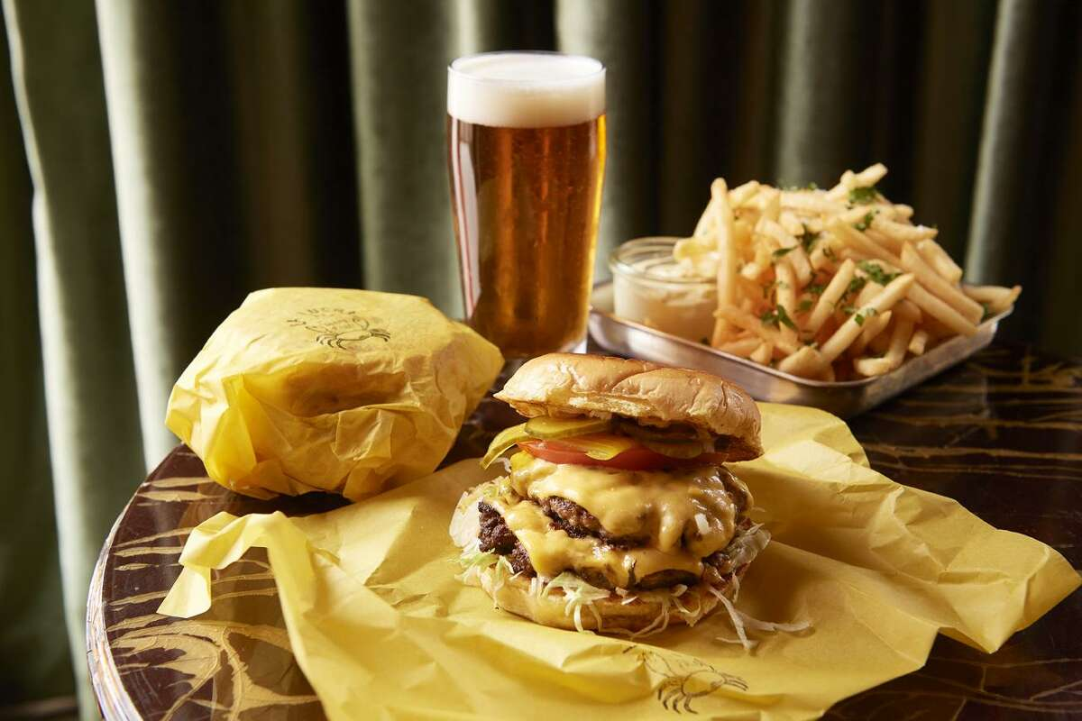 """La Lucha1801 North ShepherdTake advantage of the """"Reverse Late Night"""" menu at La Lucha in the Heights from 12 p.m. to 5 p.m. Highlights include loaded hash browns, biscuits and gravy and the Pharmacy Burger, a double-double cheeseburger (pictured)."""