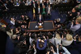FILE - In this April 10, 2018, file photo, Facebook CEO Mark Zuckerberg arrives to testify before a joint hearing of the Commerce and Judiciary Committees on Capitol Hill in Washington, about the use of Facebook data to target American voters in the 2016 election. We may remember 2018 as the year in which technology's dystopian potential became clear, from Facebook's role enabling the harvesting of our personal data for election interference to a seemingly unending series of revelations about the dark side of Silicon Valley's connect-everything ethos. (AP Photo/Pablo Martinez Monsivais, File)