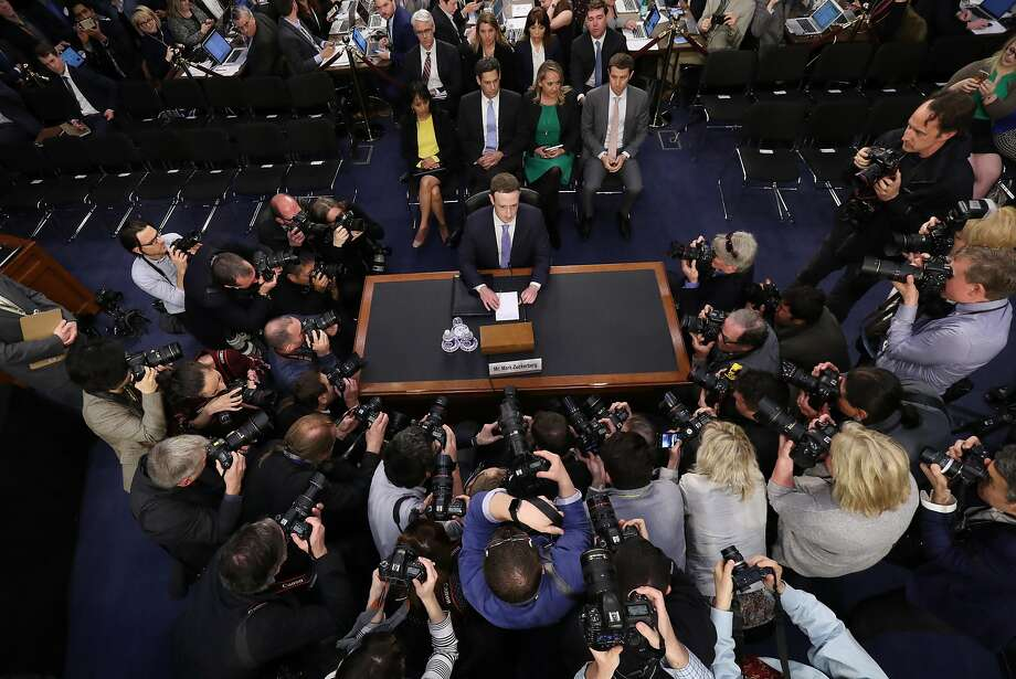 FILE - In this April 10, 2018, file photo, Facebook CEO Mark Zuckerberg arrives to testify before a joint hearing of the Commerce and Judiciary Committees on Capitol Hill in Washington, about the use of Facebook data to target American voters in the 2016 election. We may remember 2018 as the year in which technology's dystopian potential became clear, from Facebook's role enabling the harvesting of our personal data for election interference to a seemingly unending series of revelations about the dark side of Silicon Valley's connect-everything ethos. (AP Photo/Pablo Martinez Monsivais, File) Photo: Pablo Martinez Monsivais, Associated Press