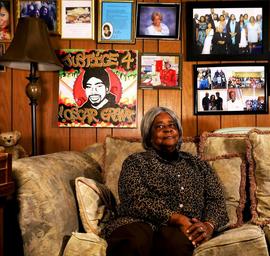 Bonnie Johnson, Oscar Grant's grandmother, has covered the walls of her Hayward home with family photos. Behind the sofa in the den is a portrait of her grandson that was made for Grant's mother, Wanda Johnson. Photo: Yalonda M. James / The Chronicle